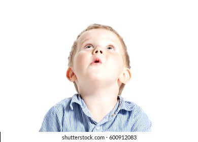 Very cute surprised little boy, isolated. Large copy-space. Cute boy face in astonishment and looking up, isolated over white