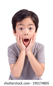 A very cute young surprised boy looking at camera, Isolated on white