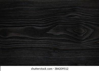Very dark wood texture close up