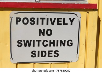 A very descriptive sign not allowing any switching of sides.