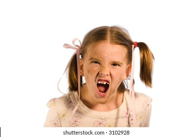 Very dirty young girl having a tantrum. Studio shot isolated on a white background.