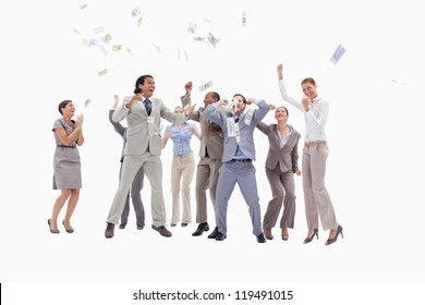 Very enthusiast people jumping and raising their arms with money falling from the sky against white background