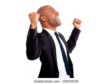 Very excited African business man with his arms in the air shot in an isolated background