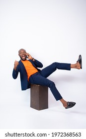 very excited handsome young black man rejoices and expresses his excitement while making a phone call