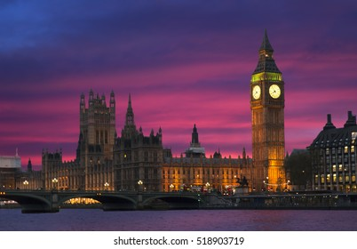 The very famous london icon of Parliament palace and Big Ben bell tower at dusk during a stunning sunset and illuminated