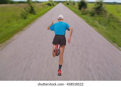 Very fast running man on a blur effect road