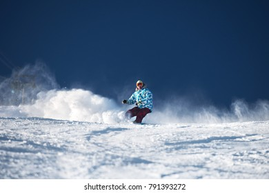 Very fast snowboarder at ski slope. Snowboarding concept with place for text