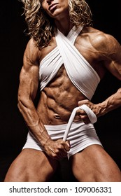 Very Fit and Toned Female BodyBuilder showing her Ads