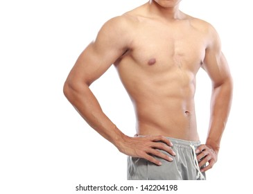 a very fit young male flexing his muscles
