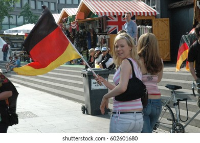 Very good-tempered German and Ecuadorian soccer fans at the 2006 World Cup at Breitscheidplatz in Berlin on 20 June 2006 (before the match between Ecuador and Germany), Germany