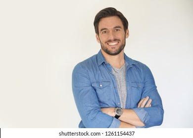 Very handsome casual man smiling and standing on white background