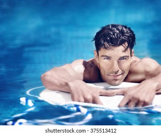 Very handsome young man in pool