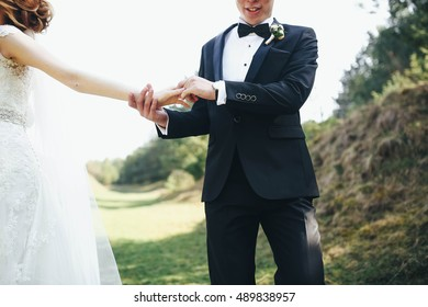 very happy and beautiful couple walk in the forest