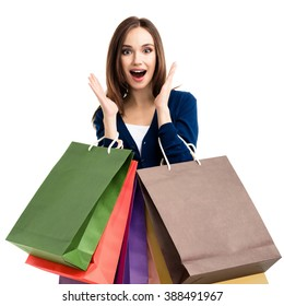 1257c3fc5 Very happy beautiful young woman in casual clothing with shopping bags,  isolated over white background