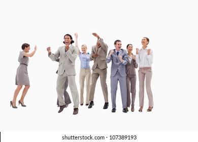 Very happy business people jumping and clenching their fists against white background