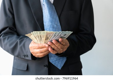 Very happy businessman with money in hand. (Success, freedom, financial prospects, career advancement)