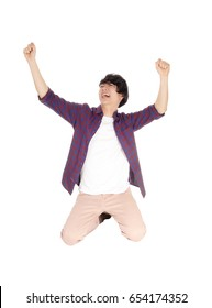 A very happy and cheerful young Asian man kneeling on the floor with