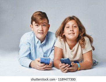 a very happy kids with smartphones. Stusio portrait