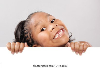 Very happy little girl showing off copy space