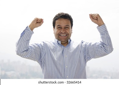 Very happy man with his arms raised