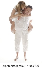 Very Happy Partners While Husband Carrying His Wife at his Back. Isolated on White.