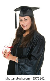 Very happy and proud beautiful young woman in graduation robe, cap & gown smiling and holding her diploma or degree. She has moved the tassle from the left to the right side of the mortarboard.