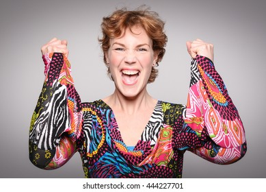 Very happy winner. Portrait of a woman having a lot of fun. Concept of triumph.