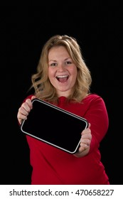 A very happy woman with a tablet
