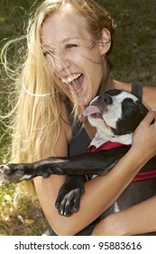 Very happy young lady and her Pit Bull dog breed