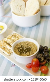 A very healthy Lebanese breakfast with bread, zaatar spread, hallumi cheese, olives and tomatoes. Very typical dish of lebanon and Mediterranean cuisine.