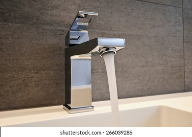 Very high end faucet, sink, and counter in a luxury bathroom - with water split on