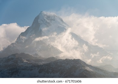 very high snow mountain peak over the clouds level for background