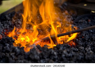 A very hot fire used by a blacksmith.