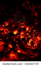 Very hot red charcoal in the fireplace.