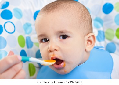 Very hungry baby child close up