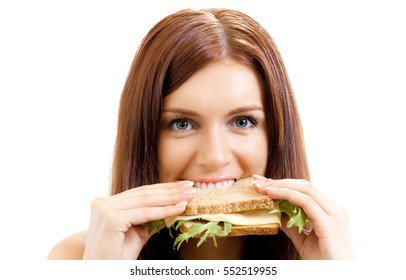 Very hungry gluttonous woman eating sandwich with cheese, isolated on white background. Dieting and weight lossing concept.