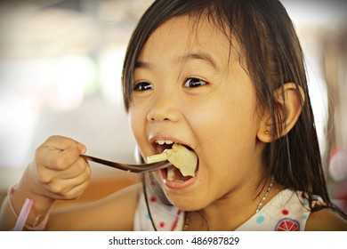 I'm very hungry /  Young girl eating noodles with hunger, and it was very tasty