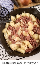 very irish meal, cooked corned beef hash in a cast iron pan