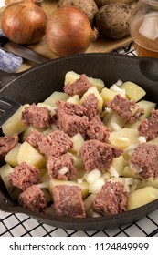 very irish meal, raw corned beef hash in a cast iron pan