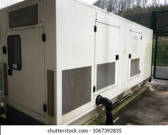 A very large electric Power generator driven by diesel fuel for a data centre. Outdoors equipment plant modern technology industrial scale Business university
