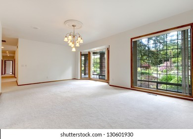Very large empty living room with  sliding doors to the back yard.