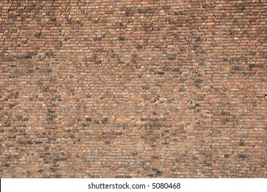 Very large expanse of old brick wall with a variation of a huge amount of bricks of different colours for background Landscape view