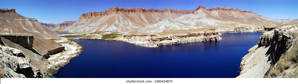 Very large panorama (49MP). Band-e Amir lakes near Bamyan (Bamiyan) in Central Afghanistan. Band e Amir was the first national park in Afghanistan. The natural blue lakes are formed by travertine dams