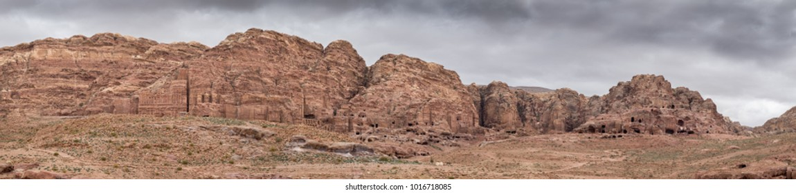 Very large panoramic view of Rock cut tombs in the ancient Arab Nabatean Kingdom city of Petra.  Jordan