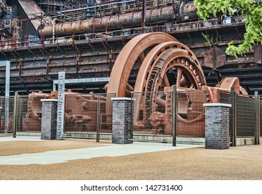 A very large steel flywheel at an abandoned steel mill