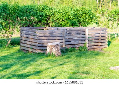 Very large three section wooden compost box standing in the Swedish garden at countryside for ecological composting of food and garden waste, organic recycling in Vasterbotten, Northern Sweden, Umea