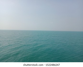 A very large and unsplashing blue ocean