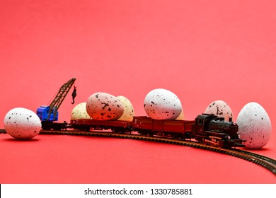 a very little train with big easter eggs against an attractive red background which may serve as an eye-catcher