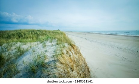 A very long and beautiful white sand beach with intense blue color of water and sky next to Skallingen, Esperance Bugt, Blavand, Esbjerg, Jutland, the Region of Southern Denmark, Scandinavia, Europe