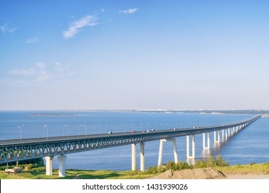 "Very long ""President"" bridge over Volga river in Ulyanovsk, Russia. Bright landscape at sunny day"